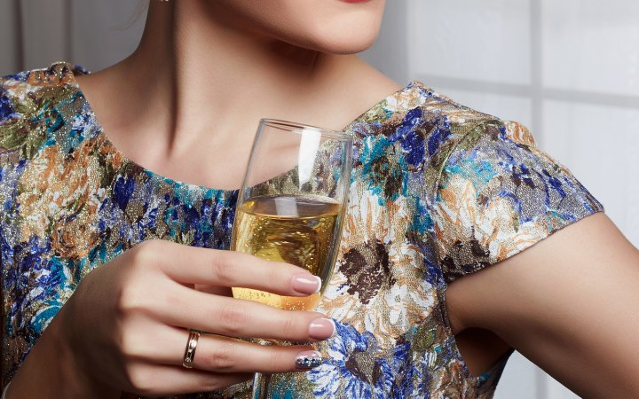 beautiful glamour woman drinking champagne.fashionable girl at the party