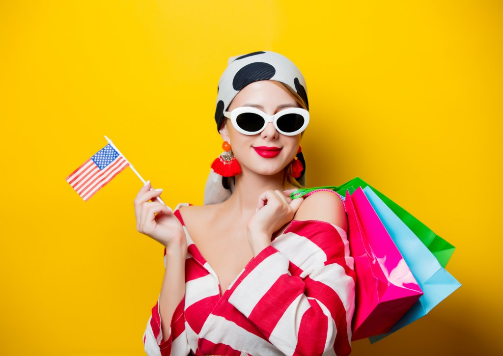 Woman with US flag and shopping bags